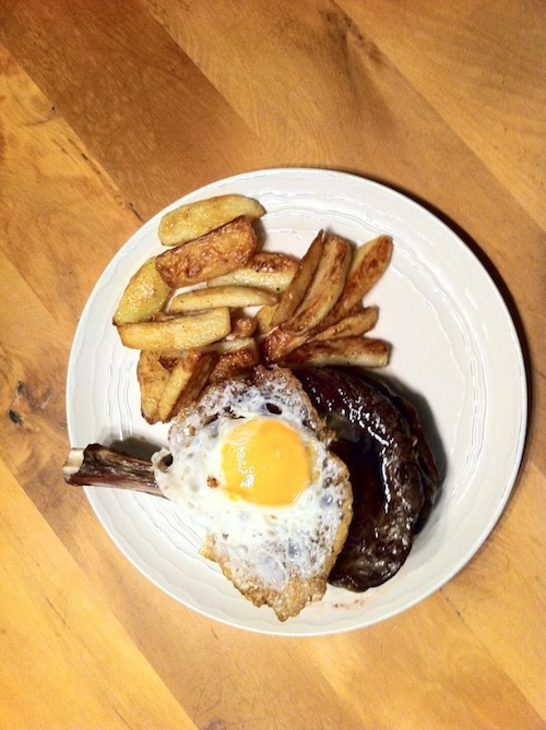 Rib roast steak with egg and chips
